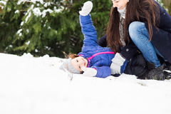 Mother with her daughter playing outside in winter nature Royalty Free Stock Image