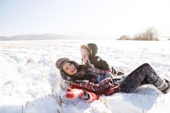 Mother with her daughter, playing in the snow. Royalty Free Stock Images
