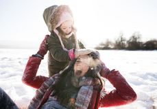 Mother with her daughter, playing in the snow. Royalty Free Stock Photos