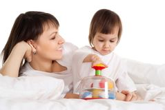 Mother with her daughter playing with a toy Royalty Free Stock Images