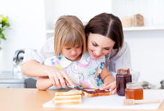 Mother and her daughter preparing a breakfast Royalty Free Stock Photos