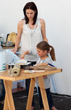 Mother and her daughter preparing paint Stock Photos