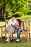 Mother and her daughter reading a book Stock Image