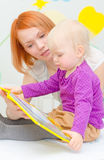 Mother and her daughter reading book. Stock Photography