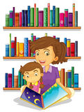 A mother with her daughter reading a book Stock Photos