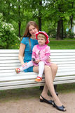 Mother and her daughter Relaxing In Garden Stock Image
