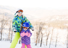 Mother and her daughter showing thumbs up at the ski resort Stock Image