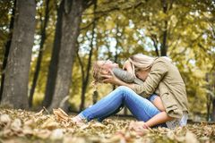 Young mother with daughter on meadow. stock image