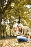 Mother and daughter in hug. Mother with her daughter sitting on meadow hugging and sitting on grass royalty free stock photos