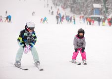 Mother and her daughter skiing. In winter time. fun time together stock photo