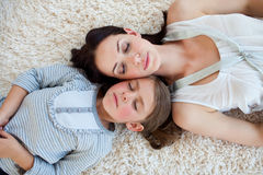 Mother and her daughter slepping on the floor Royalty Free Stock Photo