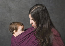 Mother with her daughter in sling Stock Photo