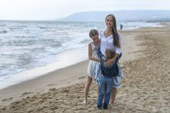 Mother and her daughter and son on the beach royalty free stock images