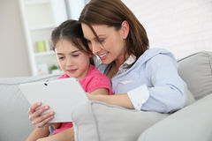Mother and her daughter surfing on internet Royalty Free Stock Images