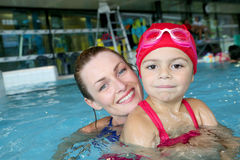 Mother and her daughter in swimming pool Stock Photo