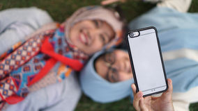 Mother and her daughter taking a selfie Stock Image