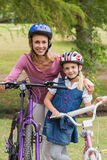 Mother and her daughter on their bike Stock Images