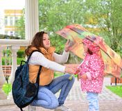 Mother  with her daughter and  umbrella in arbor Stock Photos