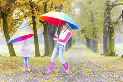 Mother and her daughter with umbrellas Stock Photo