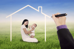 Mother with her daughter under a dream home Stock Image