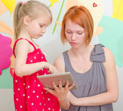 Mother and her daughter using pc. Stock Photo