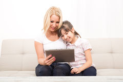 Mother with her Daughter using a Tablet PC Stock Images