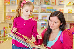 Mother and her daughter view fold-out book Stock Photography