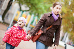 Mother and her daughter walking hand in hand Royalty Free Stock Image