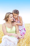 Mother and her daughter at the wheat field Royalty Free Stock Photos