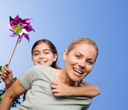 Mother and her daughter with a windmill Stock Photos