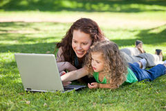 Mother and her daughter working on the laptop Stock Image