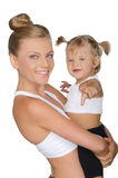 Mother with her daughter in yoga clothes Royalty Free Stock Image