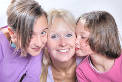 A mother  and her daughters Stock Photos