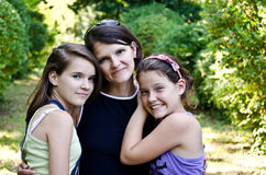 Mother and her daughters. A young mother and her daughters Royalty Free Stock Image