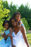 A mother and her daughters. A beautiful african american mother and her daughters enjoying the outdoors Royalty Free Stock Image