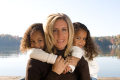 Mother and her daughters. A beautiful mixed race mother and her daughters Royalty Free Stock Images