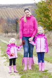 Mother and her daughters in autumn Royalty Free Stock Photography