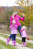 Mother and her daughters in autumn Stock Photos