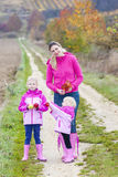 Mother and her daughters in autumn Royalty Free Stock Image