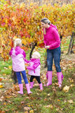 Mother and her daughters in autumn Stock Photo