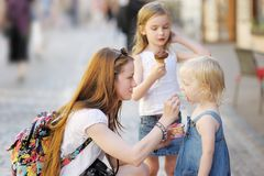 Mother and her daughters eating ice cream Stock Photos