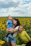 Mother with her daughters in the field with. Royalty Free Stock Images