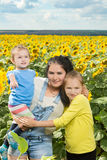 Mother with her daughters in the field with. Royalty Free Stock Photography