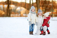 Mother and her daughters having fun on winter day Royalty Free Stock Photo