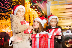 Mother and her daughters with New Year apparel Royalty Free Stock Photography