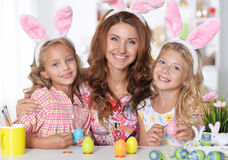 Mother and her daughters painting Easter eggs Royalty Free Stock Image