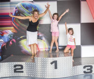 A mother and her daughters on a podium of competition Stock Photo
