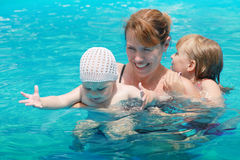 Mother and her daughters swim Stock Image