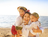 Mother and her daughters at tropical beach Stock Images