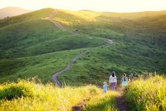 Mother and her daughters walking in hills Royalty Free Stock Photo